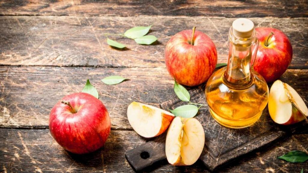 apples and apple cider in glass